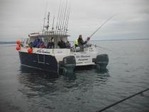 Happy anglers aboard Bite Adventures