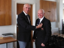 Peter Neal recieving his silver pin from Jim Whippy