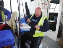 Pete Bailey sitting comfortable preparing his bait